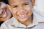 Close up of African American boy with mother — Stock Photo