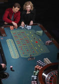 Couple gambling in a casino — Stock Photo