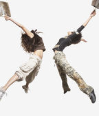Women jumping for joy together — Stock Photo