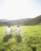 Couple relaxing in a meadow — Stock Photo