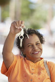 Middle-aged African woman holding up her car keys — Stock Photo