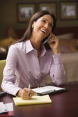 Young businesswoman talking on her cell phone — Stock Photo