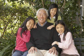 Asian grandfather with granddaughters outdoors — Fotografia Stock