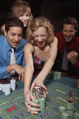 Woman successfully gambling in a casino — Stock Photo