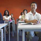 Group of adults in classroom — Stock Photo