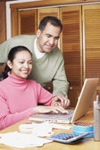 Couple using a laptop together — Stock Photo