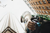 Low angle view of rock climber in urban setting — Stock Photo