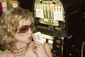 Young woman holding her winnings at the casino — Stock Photo