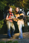 Female hikers consulting a map — Stock Photo