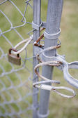 Close up of lock on chain link fence — Stock Photo