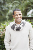 Man smiling for the camera outdoors — Stock Photo