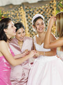 Bride celebrating with her bridesmaids — Stock Photo