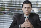 Businessman sitting with hands folded — Stock Photo
