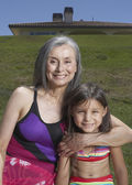 Senior woman and her granddaughter posing for the camera — Stock Photo