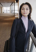 Businesswoman smiling by banister — Stock Photo