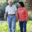 Senior Hispanic couple holding hands outdoors — Stock Photo