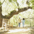 Senior Hispanic couple walking in park — Stock Photo