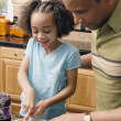 African father and daughter making peanut butter and jelly sandwich — Stock Photo