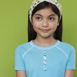 Stock Photo: Studio shot of Hispanic girl smiling