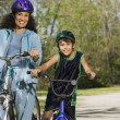 Hispanic mother and son riding bicycles - Stock Photo