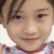 Close up of young Asian girl smiling — Stock Photo