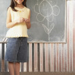 Hispanic girl drawing on blackboard - 图库照片