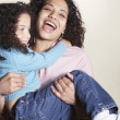 Mother carrying daughter and laughing — Stock Photo