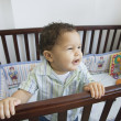 Stock Photo: Africbaby in standing crib