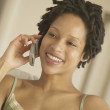 African woman using cell phone — Stock Photo