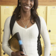 Young African woman next to school lockers — Stock Photo