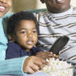 African American family watching television with popcorn — Stock Photo #23251992