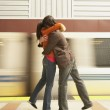 Couple hugging at train station — Stock Photo #23252082