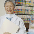 Senior female Asian dentist in office — Stock Photo