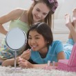 Two young girls playing with makeup — Stock Photo