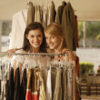 Two women shopping at clothing store — Stock Photo