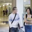 Male and female students in school hallway — Stock Photo #23252178