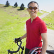 Asian man with bicycle outdoors — Stockfoto