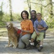 African family with dog on nature trail — Stock Photo