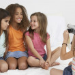 Group of young girls using video camera — Stock Photo #23252434