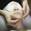 Woman receiving facial at spa — Stock Photo