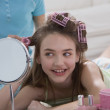 Young girl with curlers and makeup — Stock Photo #23252656