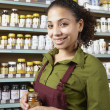 Saleswoman in health food store — Stock Photo