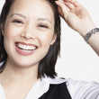 Studio shot of Asian businesswoman smiling — Stok fotoğraf