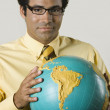 Native American businessman holding globe — Stock Photo