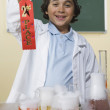 Young boy with science project holding second place ribbon — Stock Photo #23252744
