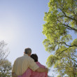 Rear view of couple hugging outdoors — Stock Photo