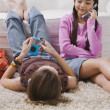 Two girls with MP3 player and cell phone — Stock Photo #23252936