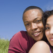 African couple hugging outdoors — Stock Photo