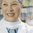 Close up of senior Asian female dentist smiling — Stock Photo