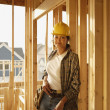 Asian female construction worker inside construction site — Stock Photo